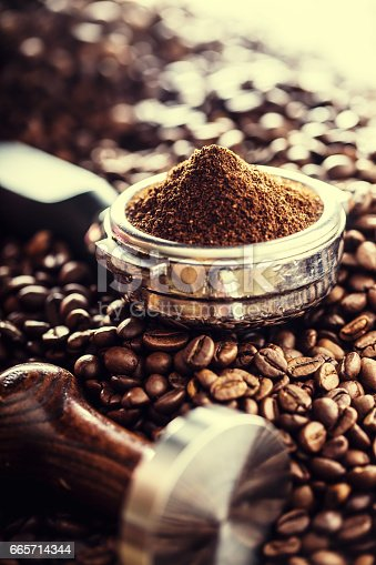 istock Coffee.Coffee beans. Coffee beans and portafilter. Toned image 665714344