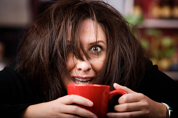 Coffee-Crazed Woman  caffeine stock pictures, royalty-free photos & images