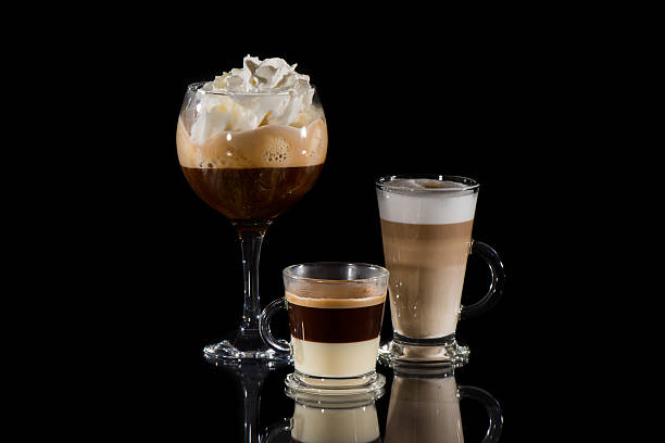 Coffees over black background with reflection stock photo
