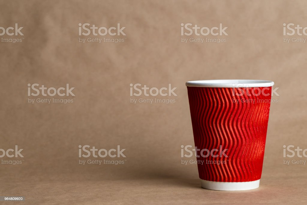coffeeto  go in a disposable cup on a craft background royalty-free stock photo