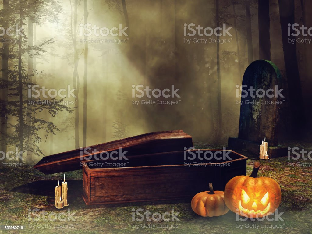 Coffin and Halloween pumpkins stock photo