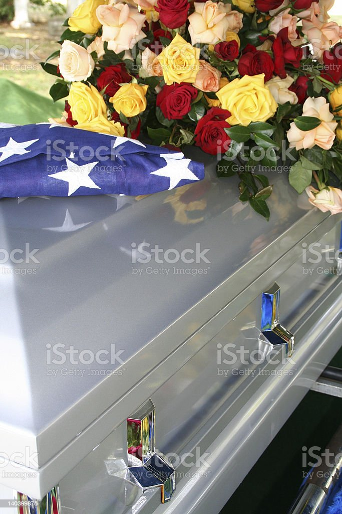 Coffin with American Flag and Flowers royalty-free stock photo