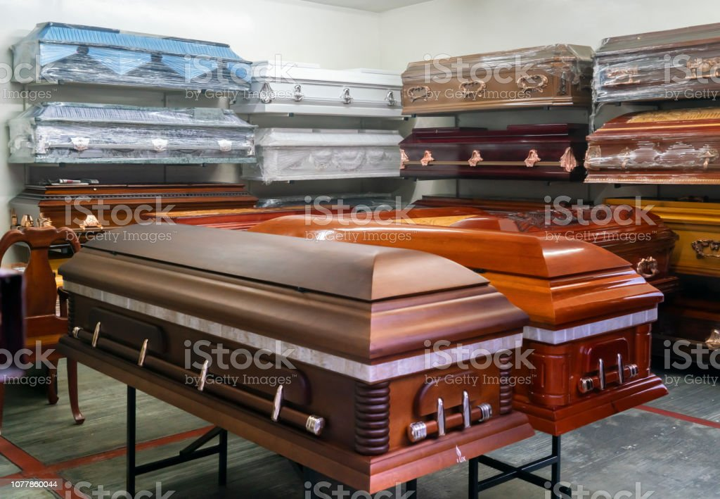 Coffins for Sale Assortment of coffins displayed in a coffin store in Oaxaca Mexico. Coffin Stock Photo