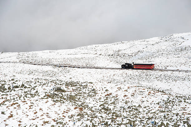 Cog Railway train heading downhill New Hampshire, USA - October 2, 2009: Cog Railway train slowly working its way down Mount Washington mount washington new hampshire stock pictures, royalty-free photos & images