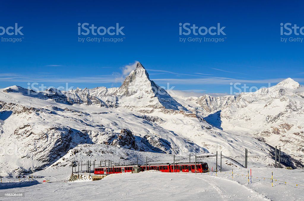 Cog train approaching the last stop at Gornergrat, Switzerland stock photo