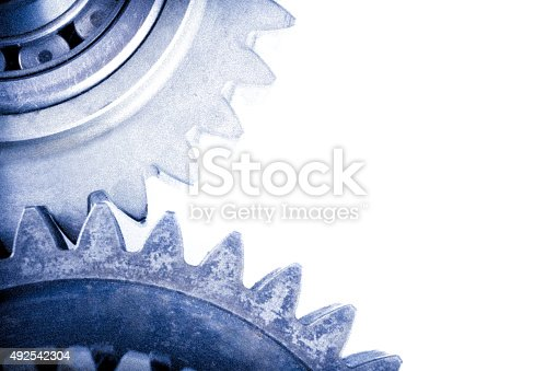 Mechanics and transmission concept with different cog and gear wheels on isolated background. Image taken with Nikon D800 and developed from RAW on isolated white background