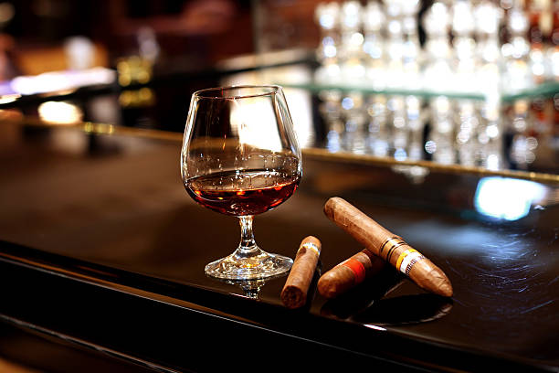Cognac and Cigars a glass of cognac and  cigars in loungesimilar images: brandy stock pictures, royalty-free photos & images