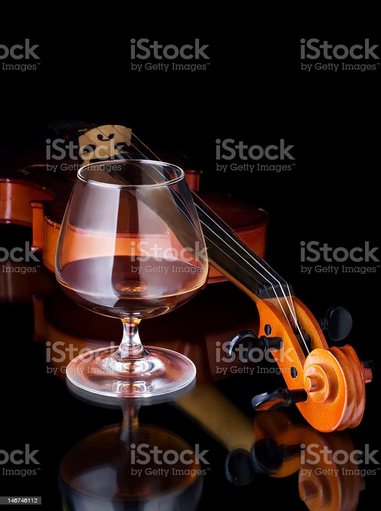 Cognac and violin royalty-free stock photo