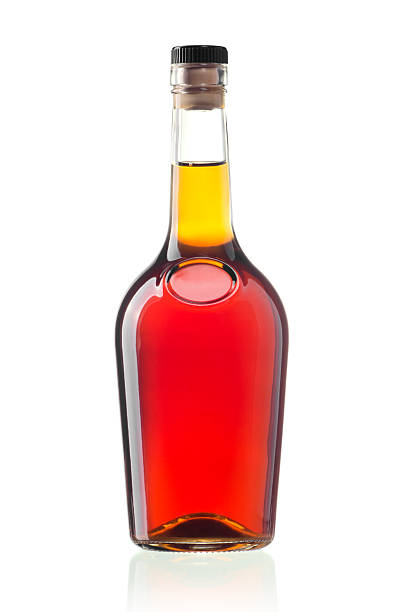 Cognac bottle The glass bottle of cognac isolated on white calvados stock pictures, royalty-free photos & images