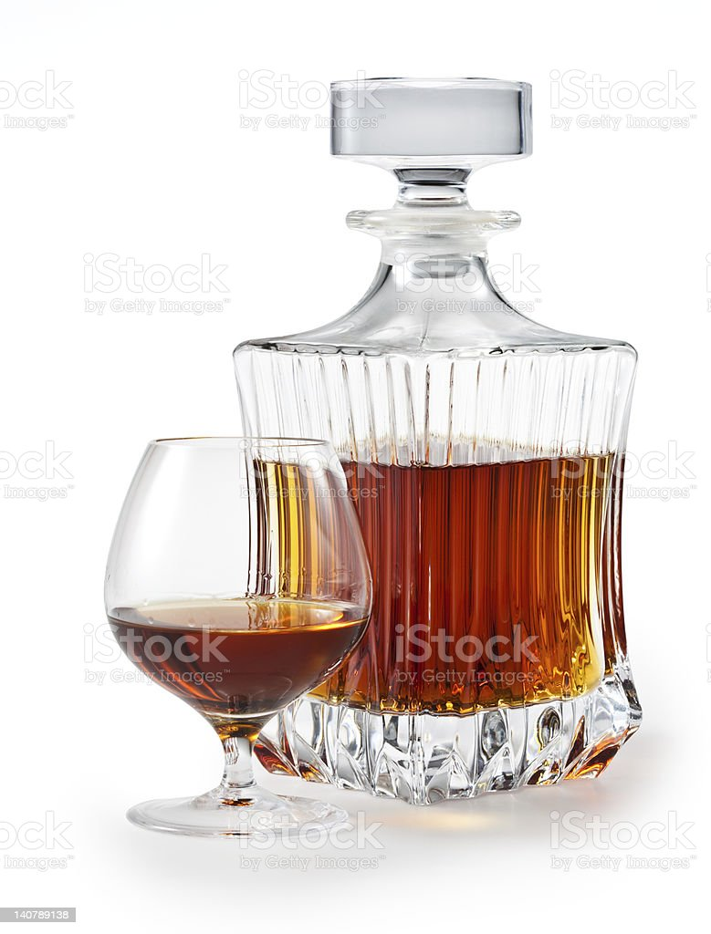 Cognac (brandy) glass and bottle isolated. clipping path stock photo