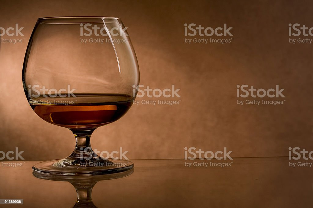 cognac  glass on vintage background royalty-free stock photo