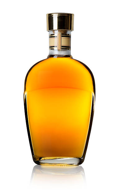 Cognac in a bottle Cognac in a bottle isolated on a white background brandy stock pictures, royalty-free photos & images