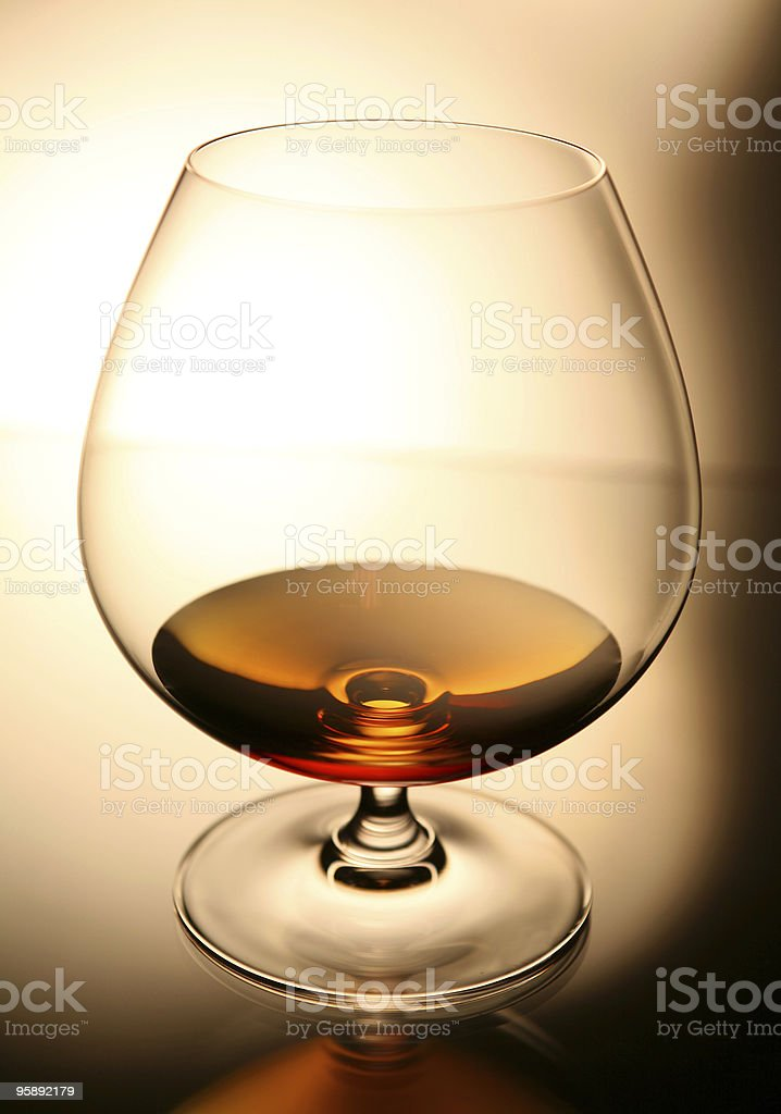 cognac in brandy snifter glass royalty-free stock photo