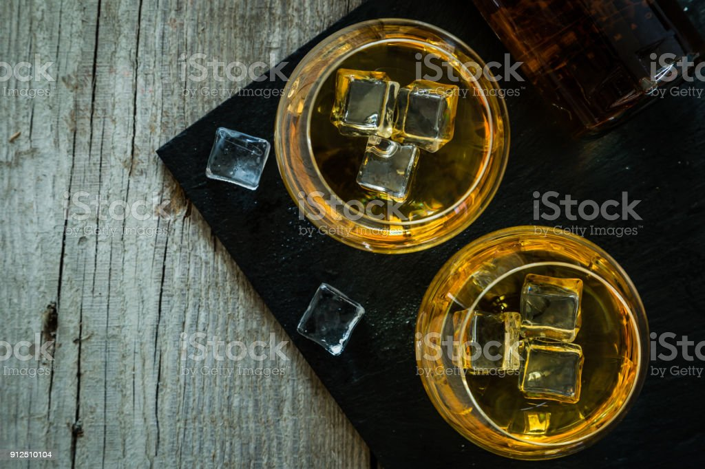 Cognac in glasses on rustic backgrpund stock photo