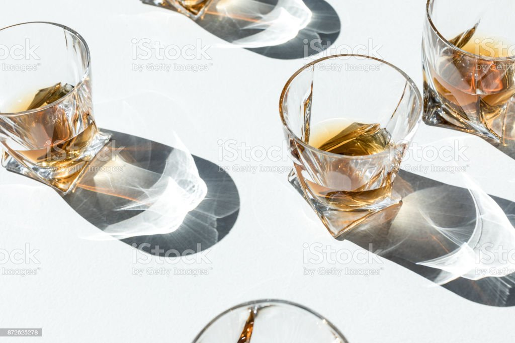 cognac in glasses with shadows stock photo