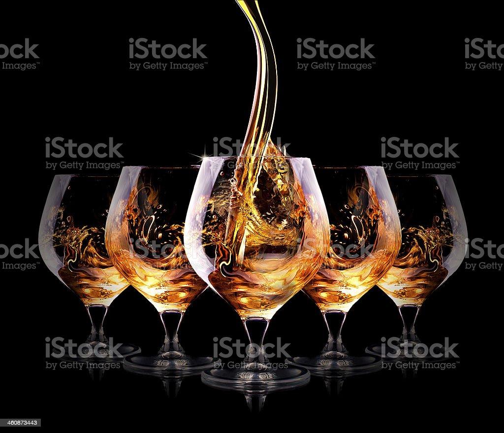 Cognac or brandy on a black stock photo
