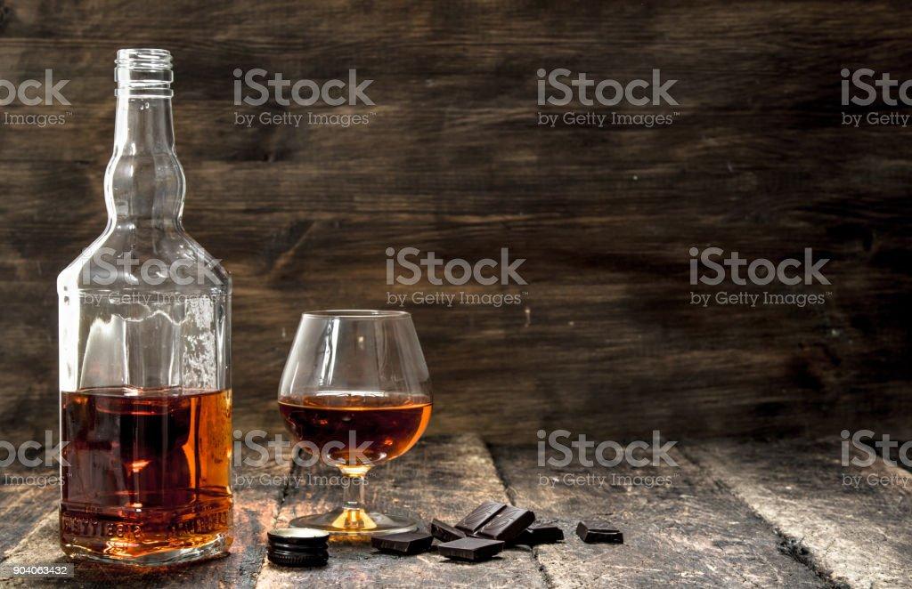 Cognac with bitter chocolate. stock photo