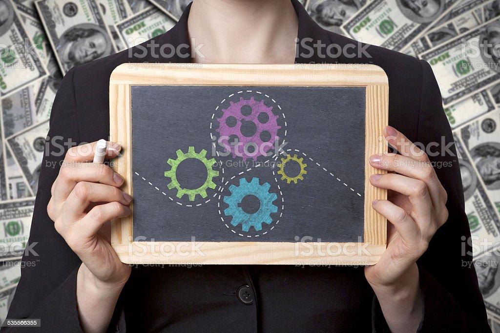 cogwheel black board stock photo