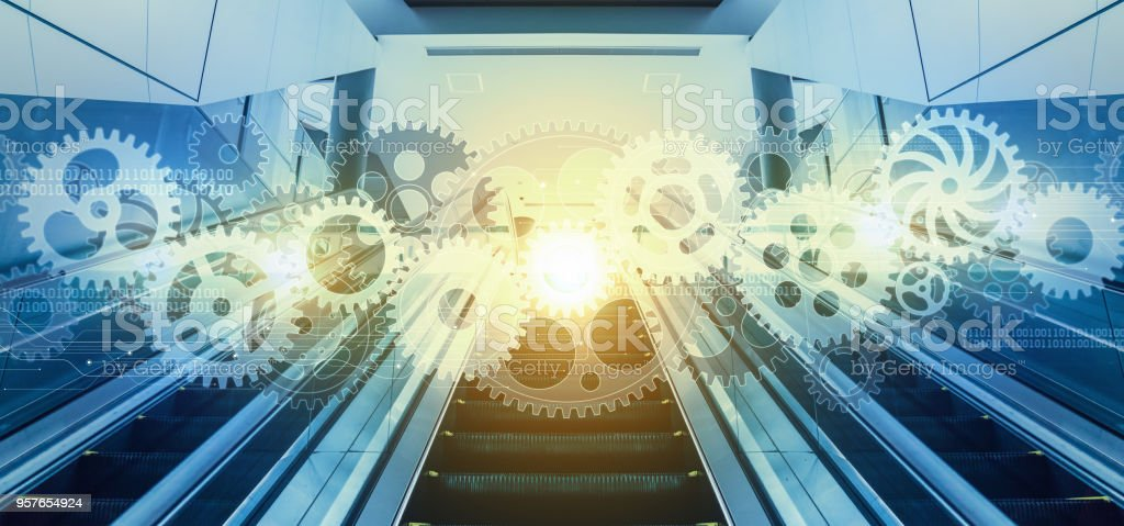 Cogwheels and modern interior. Industrial system concept. stock photo