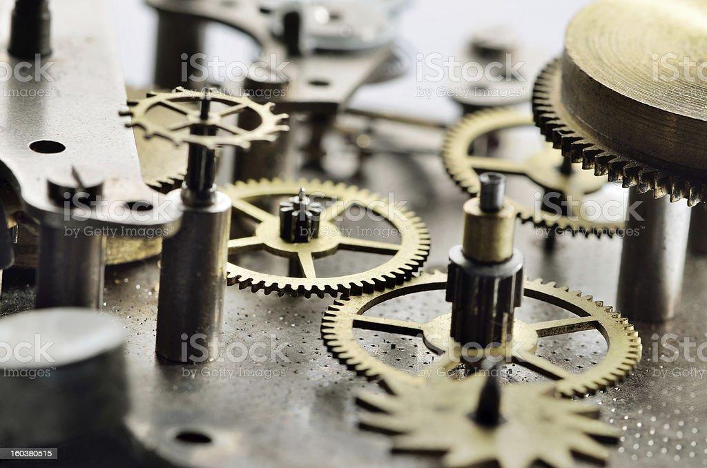 Cogwheels in old clock stock photo