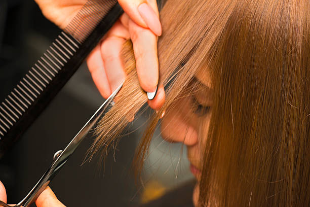 Coiffeur Aligning Haircut stock photo
