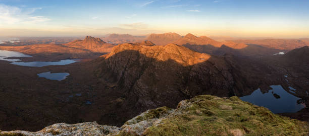 Coigach & Assynt hills, Scottish Highlands The view from Sgurr an Fhidhlier, looking to Stac Pollaidh, Suilven, Cul Mor and Cul Beag as the last of the days light touches the mountain tops. north coast 500 stock pictures, royalty-free photos & images