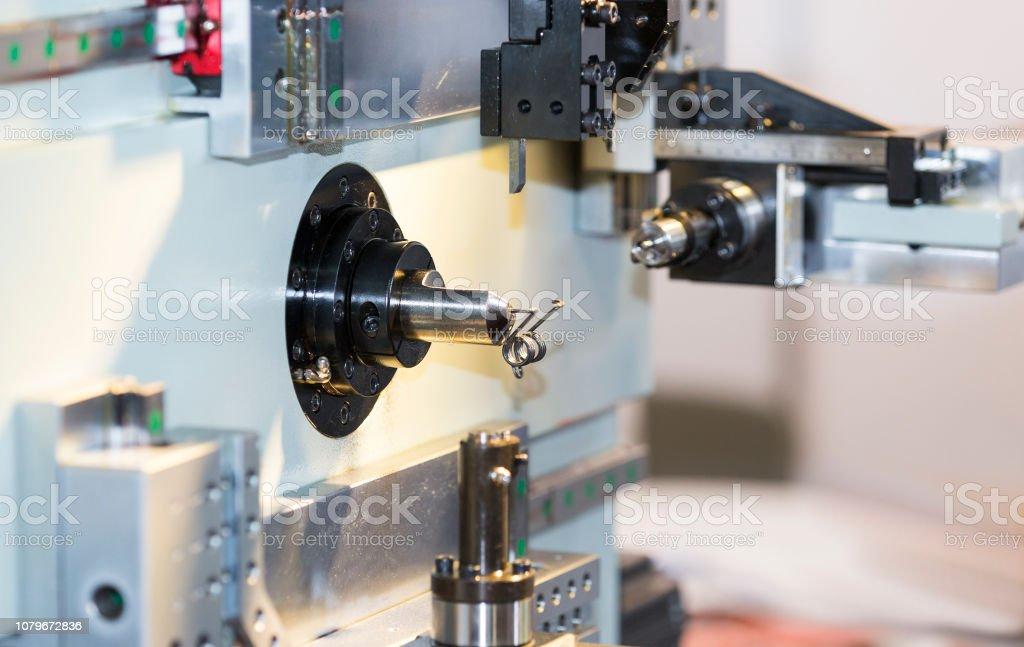 CNC coil sporing making machine stock photo