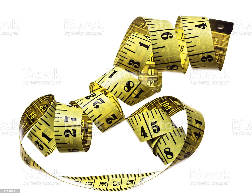 Coiled, double-sided tape measure showing inches and centimetres royalty-free stock photo