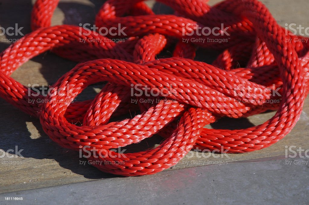 Coiled red dock rope stock photo