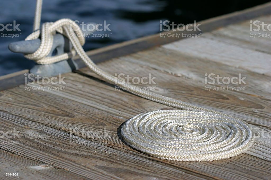 coiled rope and cleat stock photo