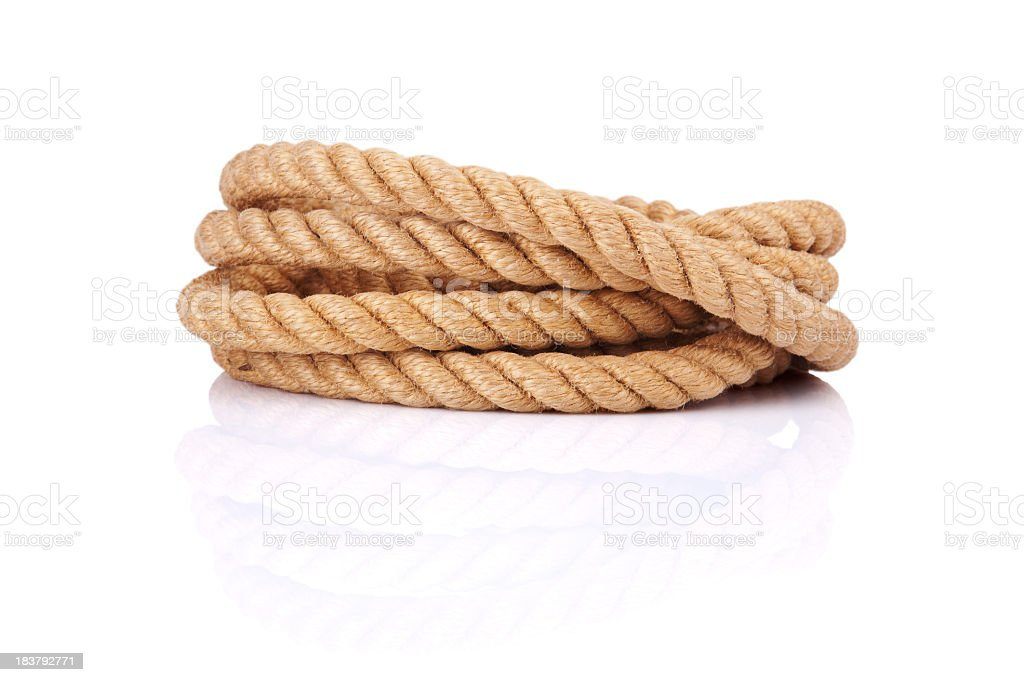 Coiled rope isolated on a white background stock photo