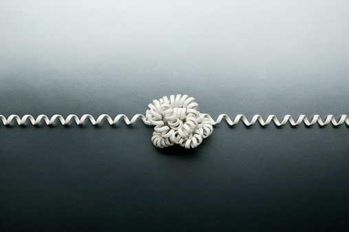 Telephone cord tied in a knot