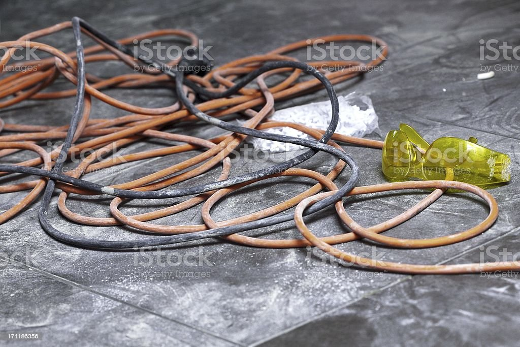 coils of electrical cable lying on floor workplace royalty-free stock photo
