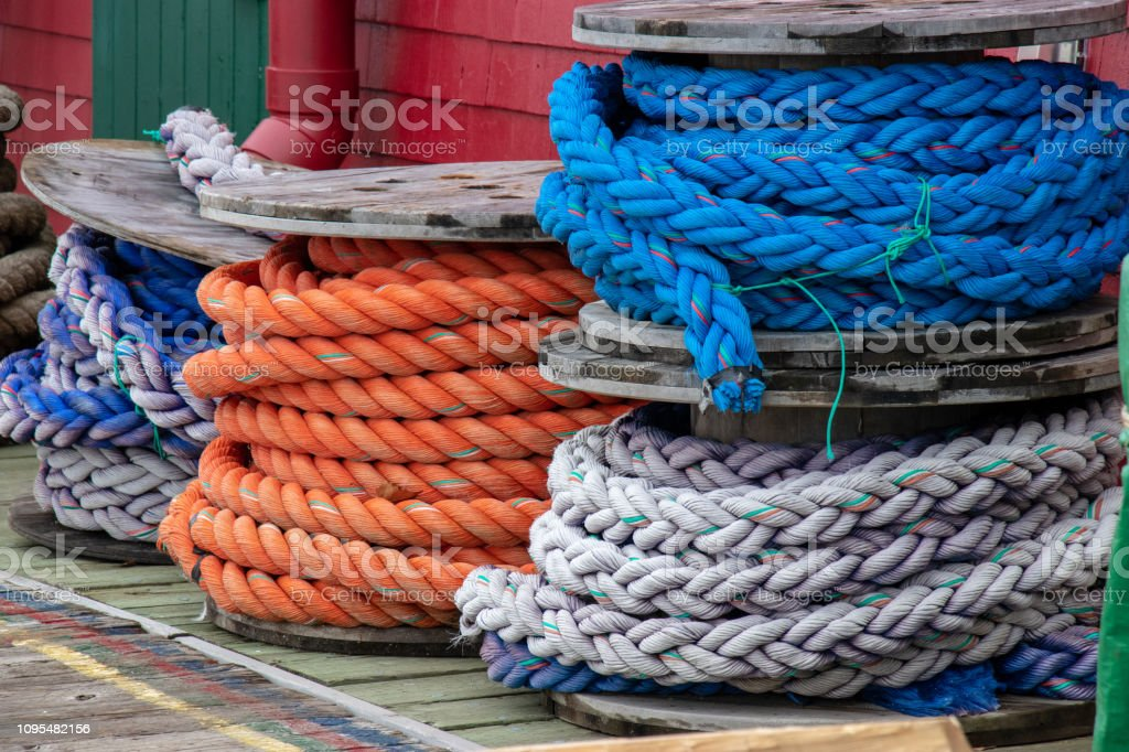 Coils of rope stored on a dock used in the fishing industry. stock photo