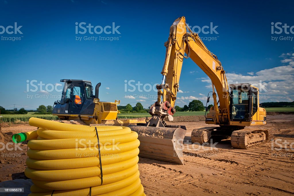 Coils of tubes and construction machinery royalty-free stock photo