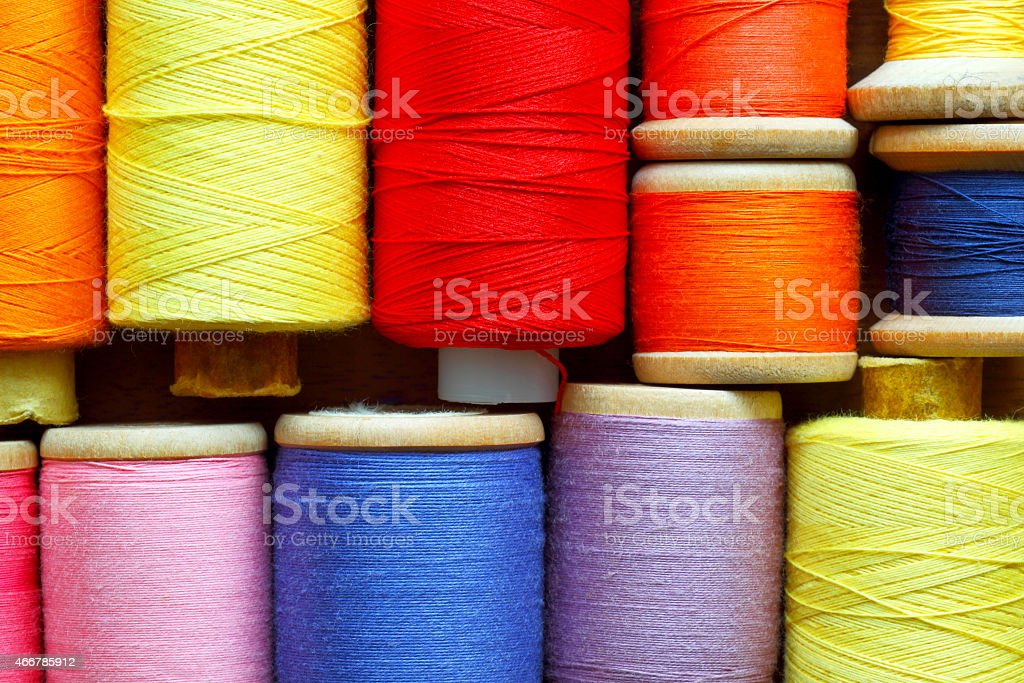 Coils with color threads. Industrial background. stock photo