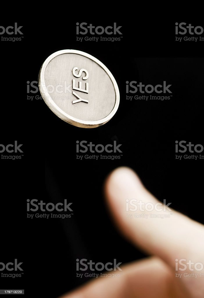 Coin flipping stock photo