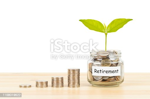 Coin glass jar container and stack on wooden desk, retirement saving concept, on white background