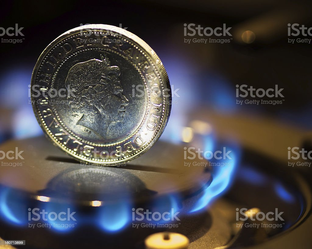 Coin in gas flame stock photo