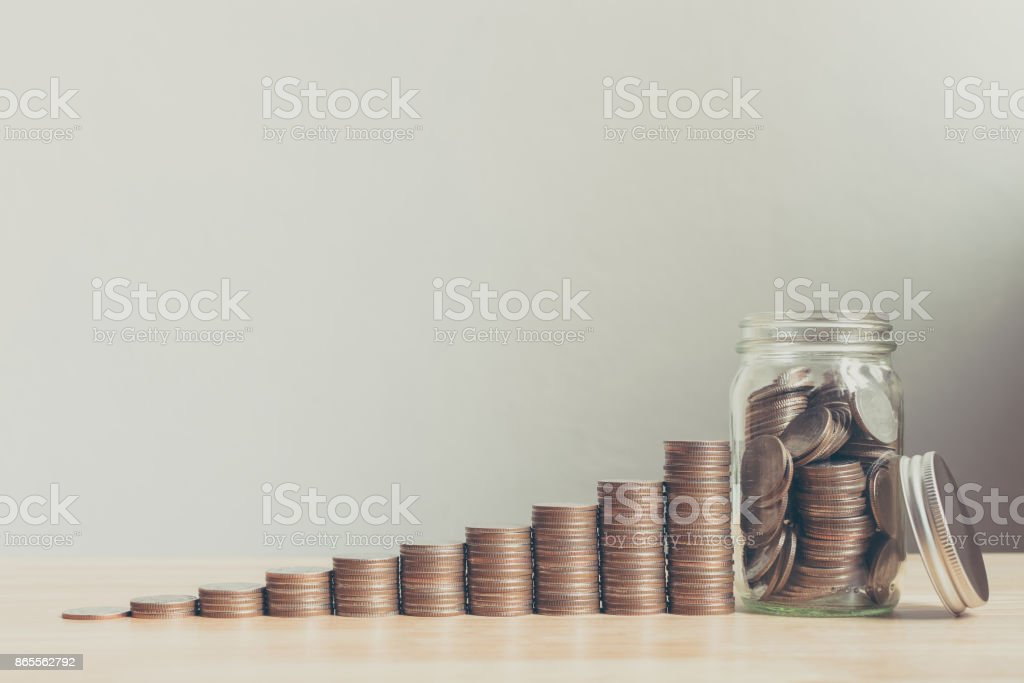 Coin in glass bottle with money stack step up growing growth saving money, Concept financial business investment, Copy space for your text stock photo
