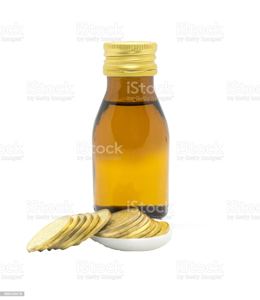 Coin in teaspoon and medicine bottle for kid health budget concept stock photo