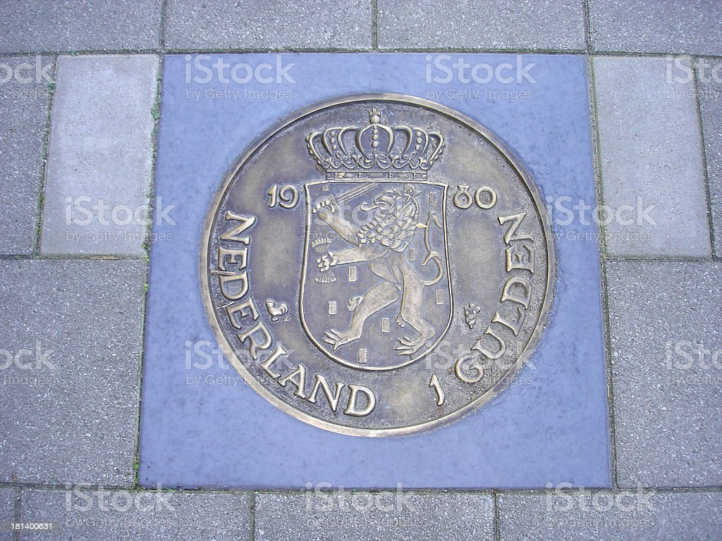 coin of one guilder in pavement royalty-free stock photo