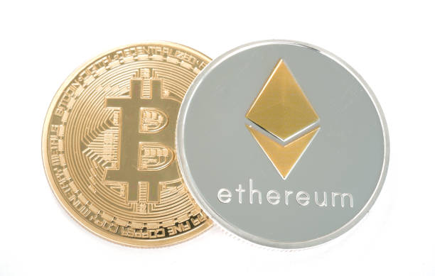Coin of Silver Ethereum and golden bitcoin isolated on white background stock photo