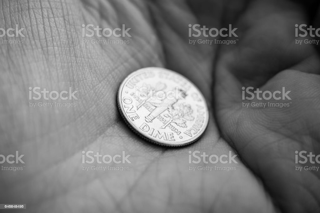 Coin on a palm of a hand stock photo