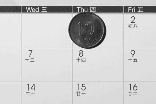 münze auf kalender - chinesischer kalender stock-fotos und bilder