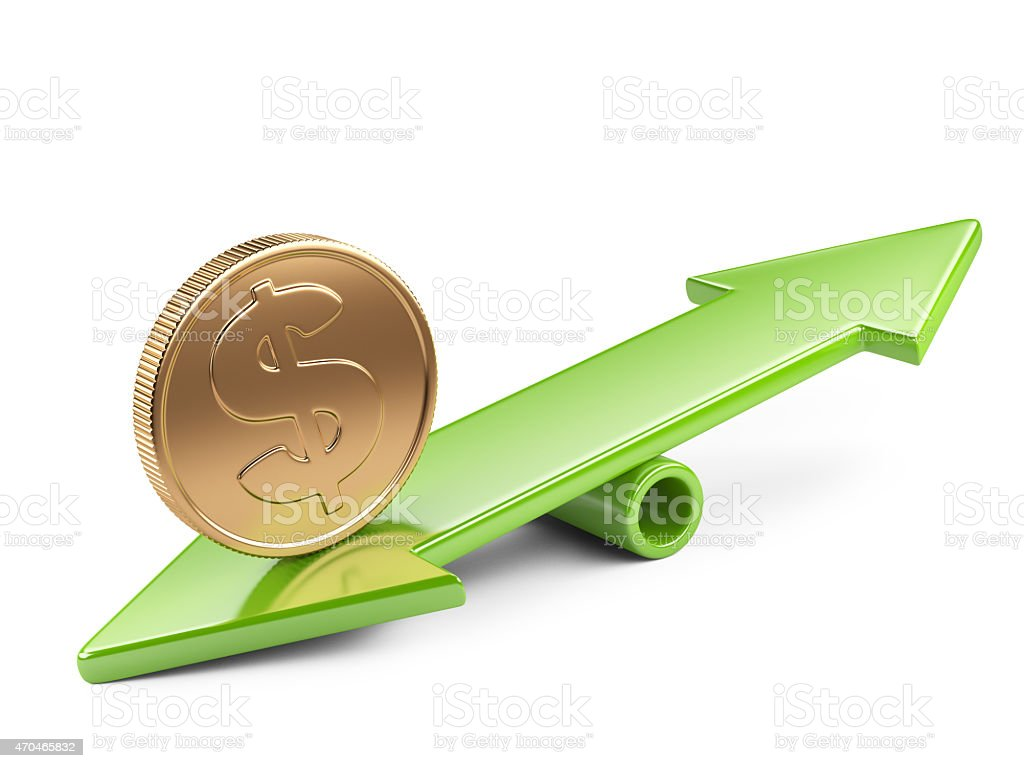 Coin on seesaw stock photo