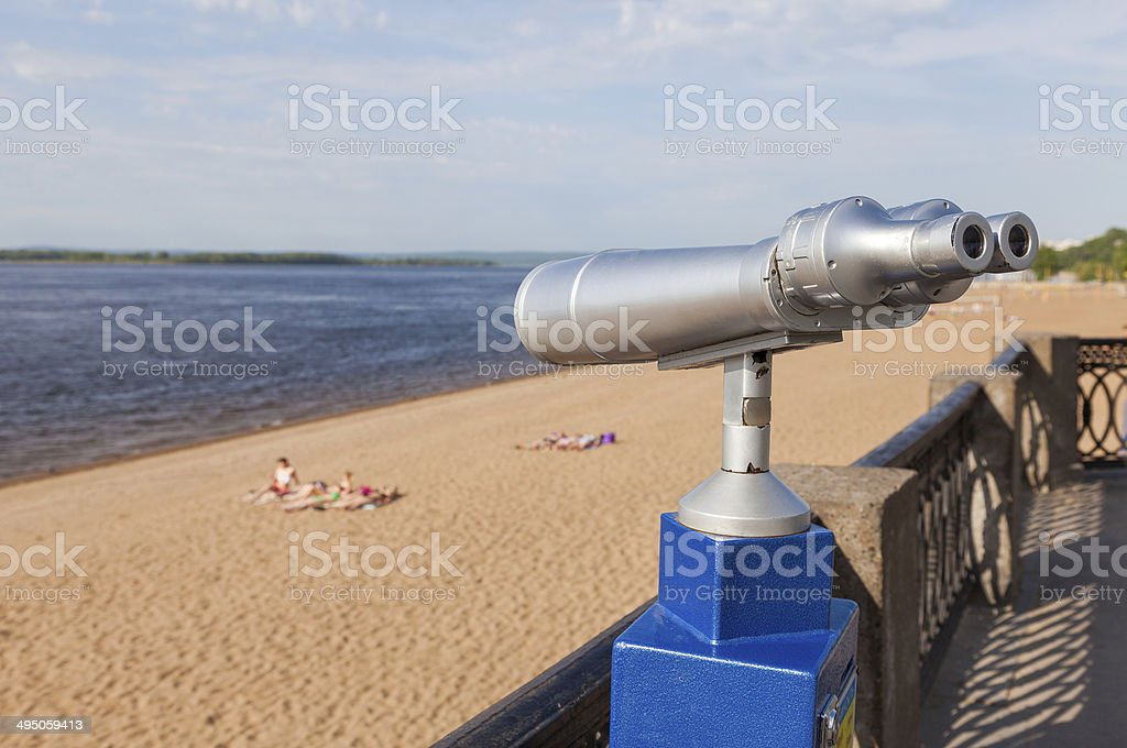 Coin operated binocular on the bank of river in summertime royalty-free stock photo