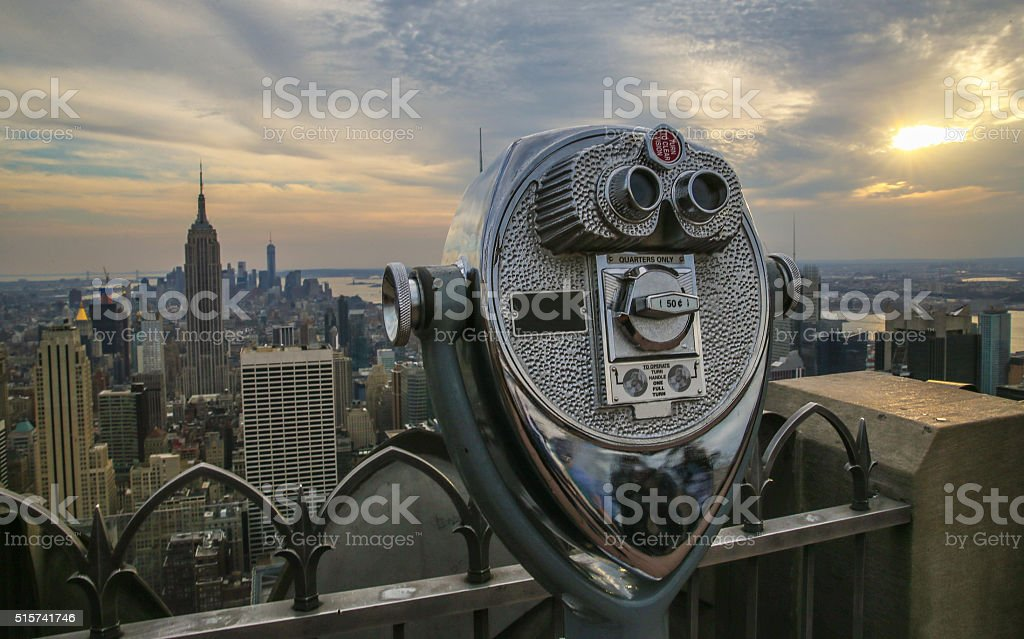 Coin operated binoculars and Empire State Building - NYC stock photo