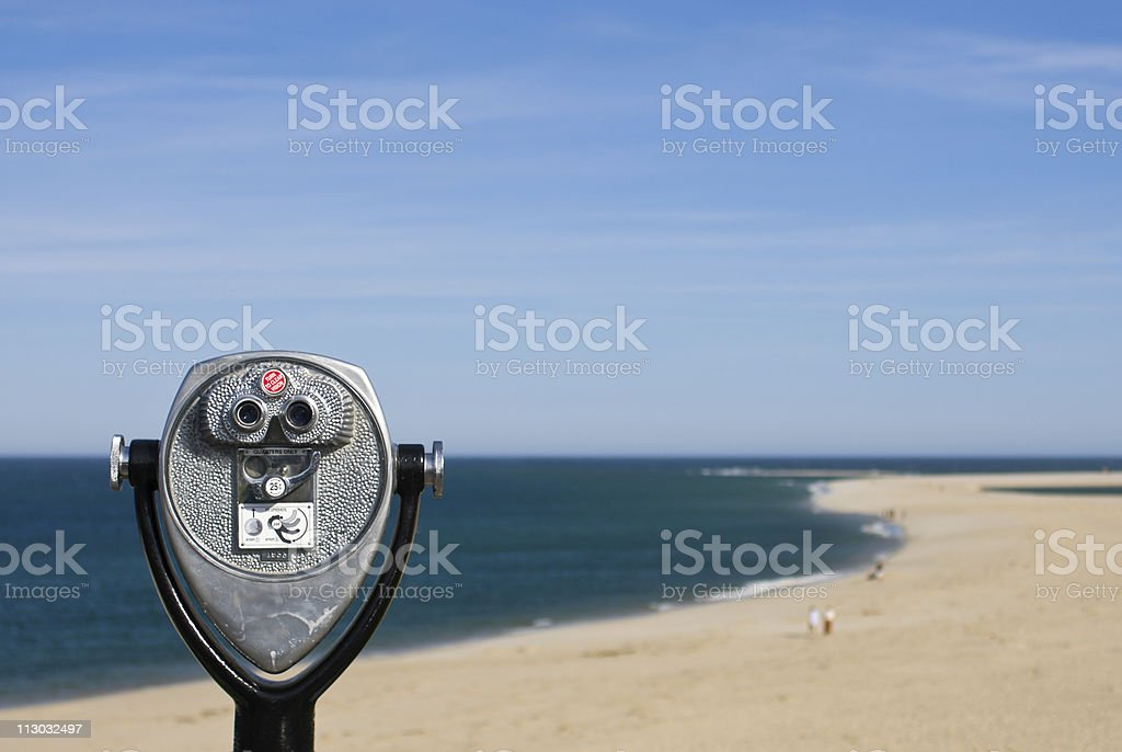 Coin operated binoculars for beach observation, blue sky and ocean stock photo