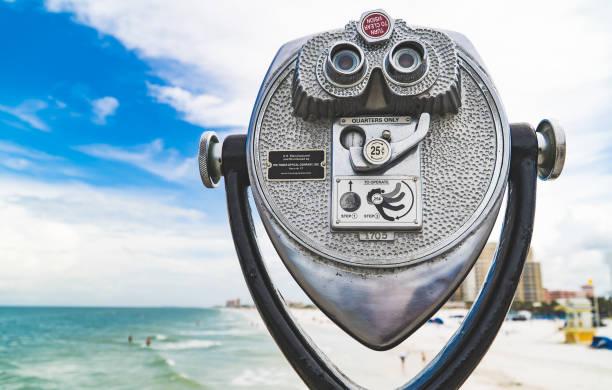 Coin operated binoculars in the beach stock photo